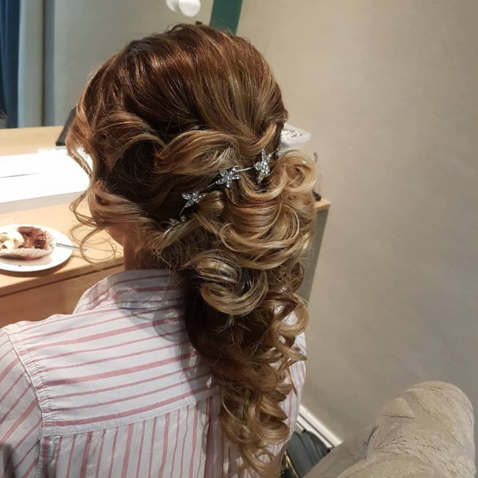 I loved creating this look. My Bride chose this style. It complimented her so much. Curls, twists, pincurls and hair vine to create this stunning look. She looked amazing! - Make Me Bridal Artist: Hair Creations North West. #curls #hairvine #weddingmorning #weddinghair #bridalhair #loosecurls #twists #bride #hairnorthwest #mobilehairstylist