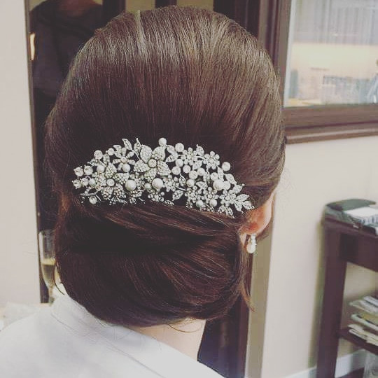 This is a bridal updo I created years ago and is still one of my favourites. It never dates. Its elegant, classy, timeless and the accessory finished the style off perfectly. - Make Me Bridal Artist: Hair Creations North West. #classic #elegant #hairup #bride #mobilehairstylist #haircreationsnorthwest #mobileweddinghair #freelance #smoothupdo