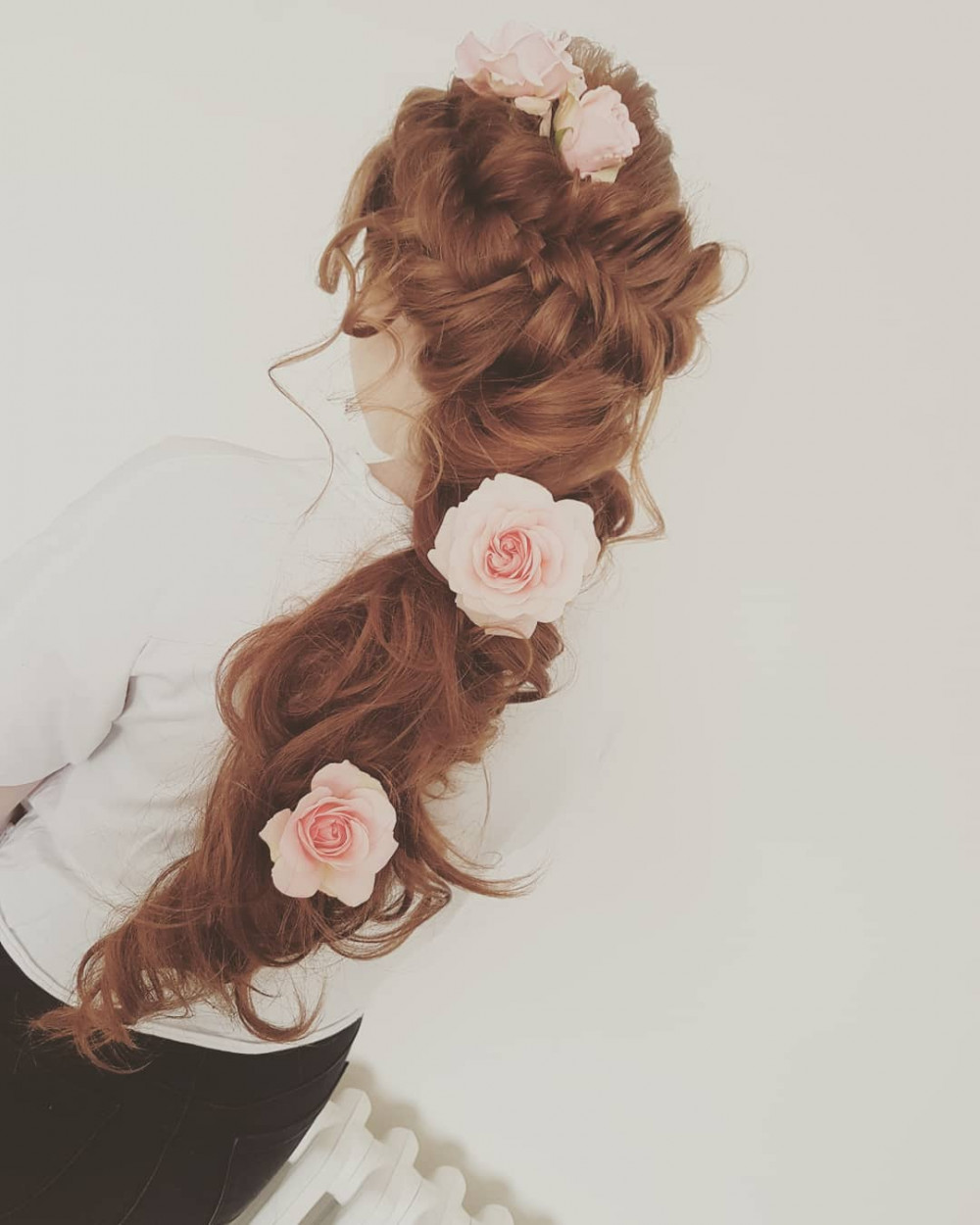 A chunky Fish plait. Bouncy curls in a pony with real roses. - Make Me Bridal Artist: Hair Creations North West. #curls #flowersinherhair #bridalhair #bridesmaidhair #rosesinhair