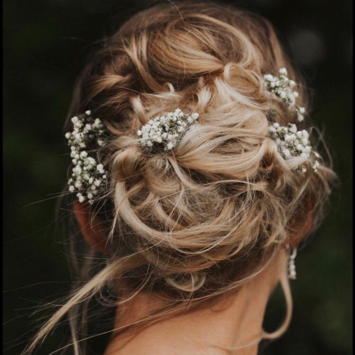 Brookfield Barn Bride Danielle wanted a messy bun with flowers. I love how perfectly imperfect the style is and how beautiful it photographs. - Make Me Bridal Artist: Jenna West Make Up. Photography by: Indiegophotography. #boho #messybun #messyupdo
