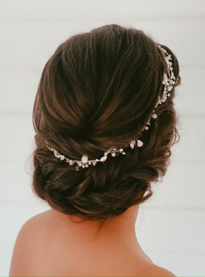 Low updo style - Make Me Bridal Artist: Abigail Blake.
