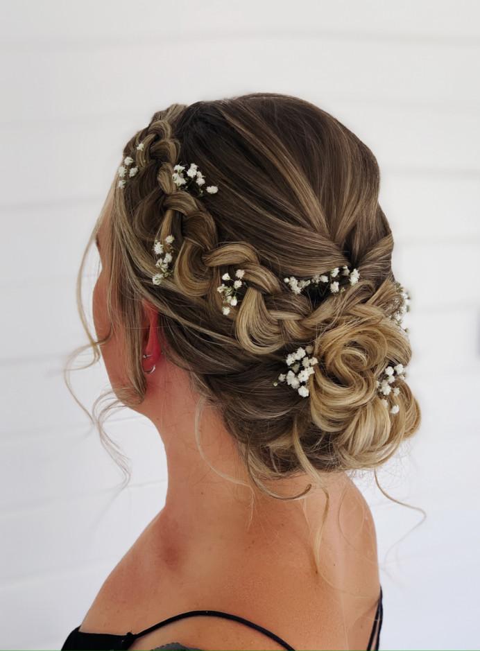 Loose messy bun with Dutch braid - Make Me Bridal Artist: Abigail Blake.