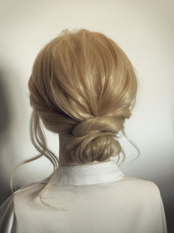 Low, tousled bun - Make Me Bridal Artist: Abigail Blake.
