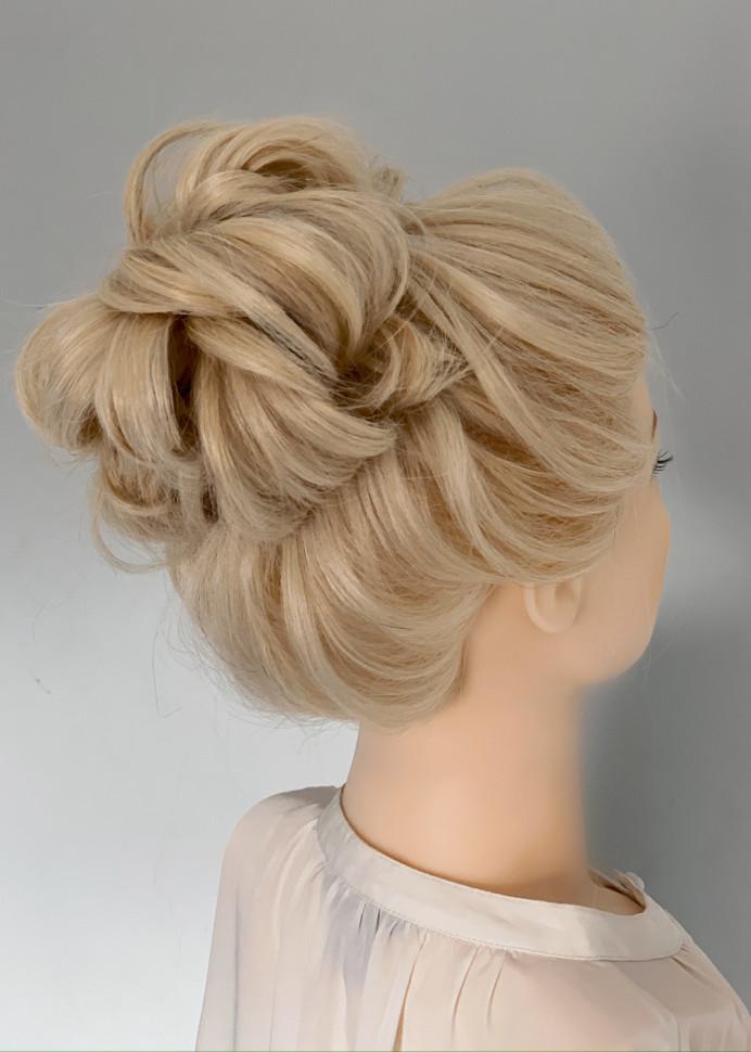 High bun with texture - Make Me Bridal Artist: Abigail Blake.