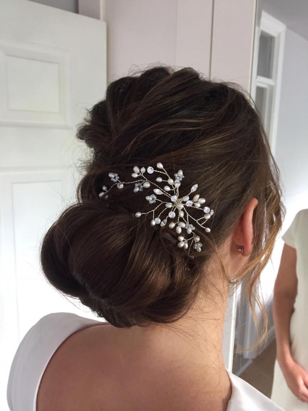 A soft & textured bun. - Make Me Bridal Artist: RDWhair. #bridalhair #weddinghair #softupdo