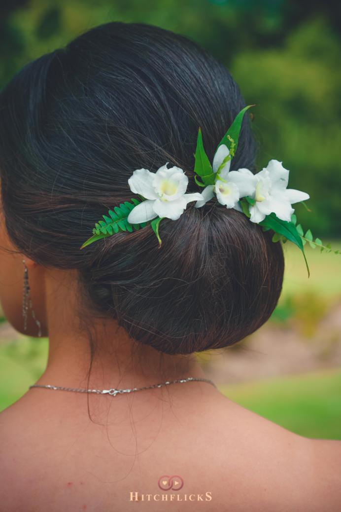 - Make Me Bridal Artist: Beautystyle. Photography by: Hitchflicks. #classic #vintage #glamorous #bridalhair #flowersinherhair #updo #chignon #elegant #brunette #lowbun #sleekupdo