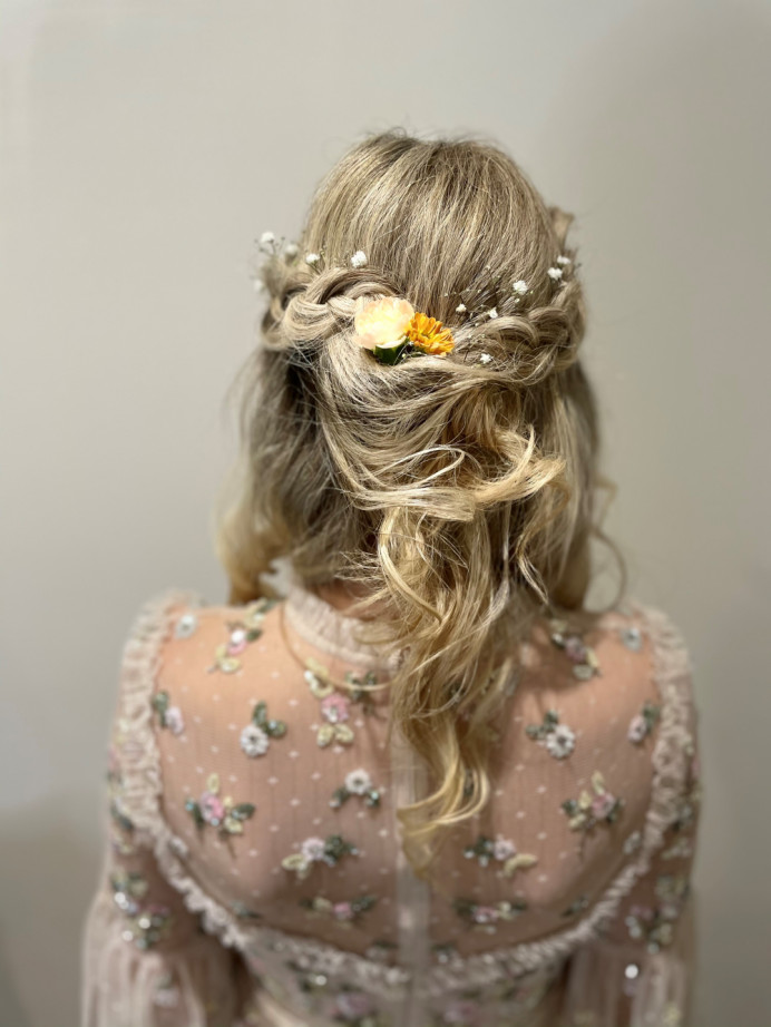 Using a dutch braid to add a boho vibe to this look, soft waves finished with slight detail at the back. Flowers were added to the back to compliment her dress. - Make Me Bridal Artist: Lucy Elliot hair and make up artist. Photography by: n/a. #halfuphair #blonde #flowersinherhair #bohobride #beachwaves #bohohair #dutchbraid #braid #gypsophila #bridalhairstylist #halfuphalfdown #loosewaves #naturalbride #softhair #bohowaves