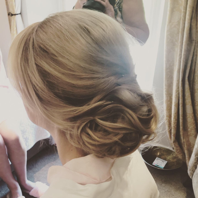 Creating a low sleek up do for this bride to go with her beautiful wedding. - Make Me Bridal Artist: Lucy Elliot hair and make up artist. Photography by: n/a. #classic #glamorous #bridalhair #updo #lowbun #blonde #longhair #classichair #timelessbeauty #stunningbride #sleekupdo