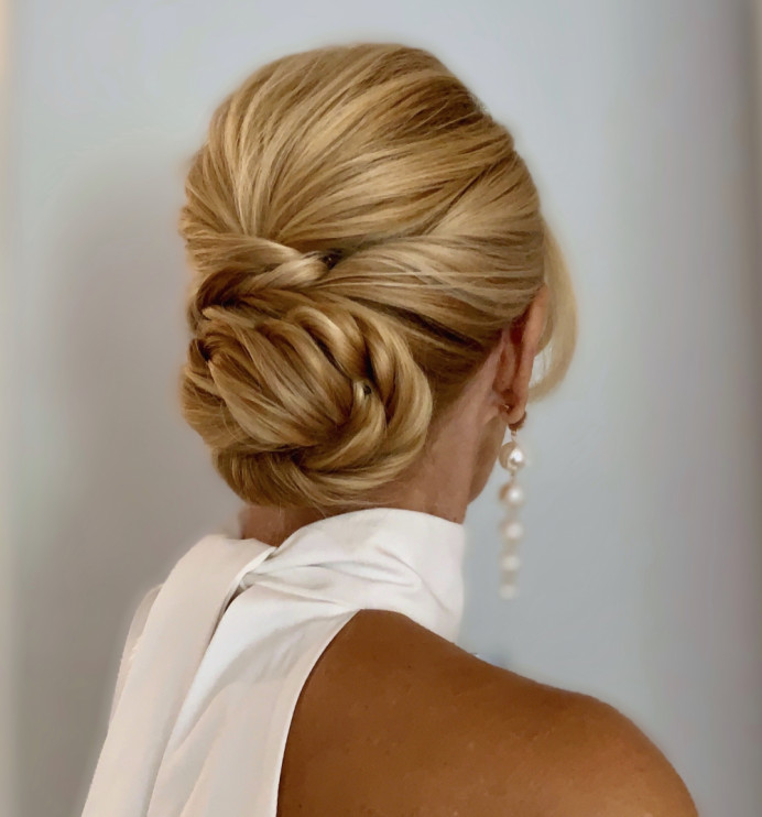 Low sleek bun for a bride. Hair by Hair That Turns Heads. - Make Me Bridal Artist: Hair That Turns Heads. #glamorous #classic #blonde #updo #soft #chignon #elegant #hairup #lowbun #hairstyling #glam #romantic #weddinghair #contemporary #sleek #chic #realbride #lowupdo #twistedupdo #sleekhair #smoothupdo #maturebride #surrey #sleekupdo #smoothbun #sleekbun
