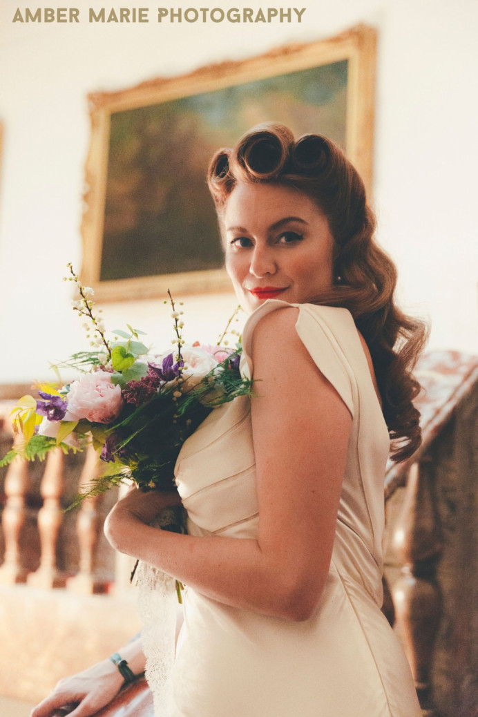 1940's victory rolls and loose curls. - Make Me Bridal Artist: Hair That Turns Heads. Photography by: Amber Marie Photography. #vintage #glamorous #halfuphair #curls #bridalhair #elegant #brunette #weddinghair #bridalhairstylist #vintagehair #hollywoodglamour #1940s #victoryroll