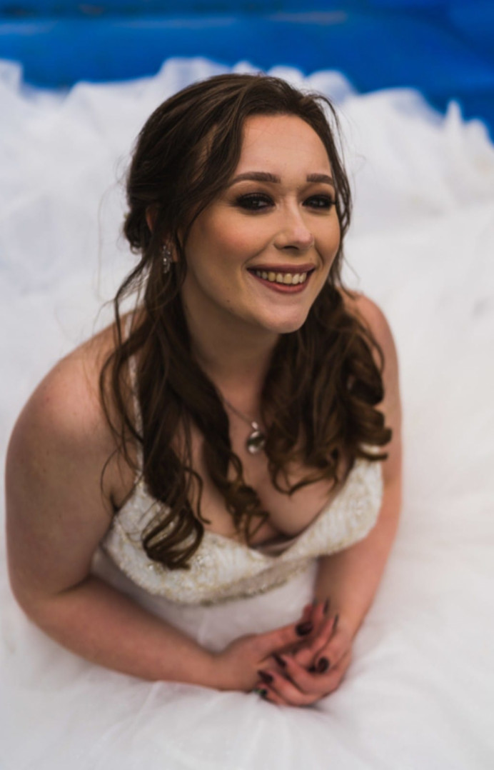 This bride wanted a relaxed, boho half up. Soft waves, pulled out fishtail braids, and soft textured height through the top, and it was exactly what she wanted. She had a 'Farm' wedding, so unique! She had heeled Doc Martens on under her wedding dress, and had an absolute ball! Her wedding, exactly how she wanted it, perfect :) - Make Me Bridal Artist: Max It Up Bridal & Special Occasion Hair. #bridalhair #bridesmaidhair #bohobride #weddinghair #halfuphair #halfuphalfdown #bohohair #braidedbridalupdo #mermaidbraid #brunettebride #brunettehair