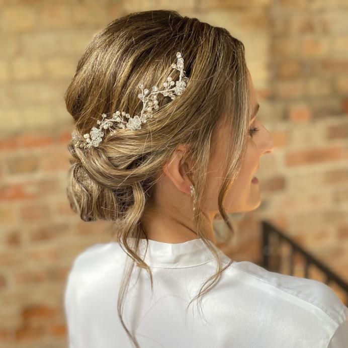 soft low bun - Make Me Bridal Artist: Zoe Sharman hair and makeup. #bridalhair #lowupdo #relaxedupdo #lowbun #undoneupdo
