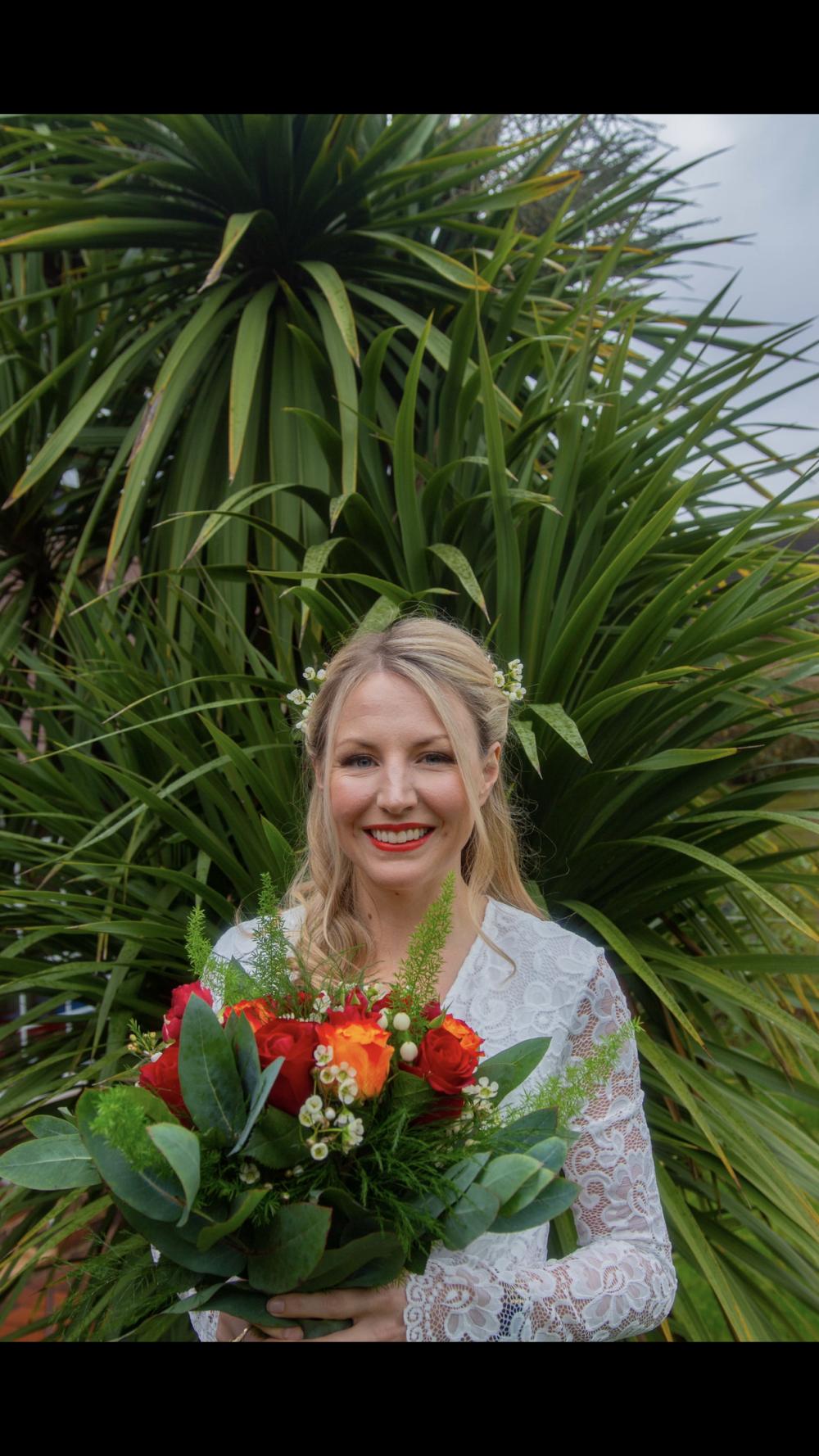 Stunning summer bride! - Make Me Bridal Artist: Ellie Nightingale Makeup. Photography by: Darcie Thompson. #bohemian #flowercrown #flowersinherhair #soft #redlip #summer #softcurls #glamourousprettyblondebridebighair