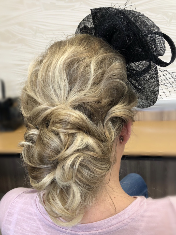 Soft bridesmaid low bun updo - Make Me Bridal Artist: Nipona Khan Professional Hair & Makeup Artist. #glamorous #blonde #lowbun #hairup #weddinghairandmakeup #hairstyling #bridemaidshair #softglam