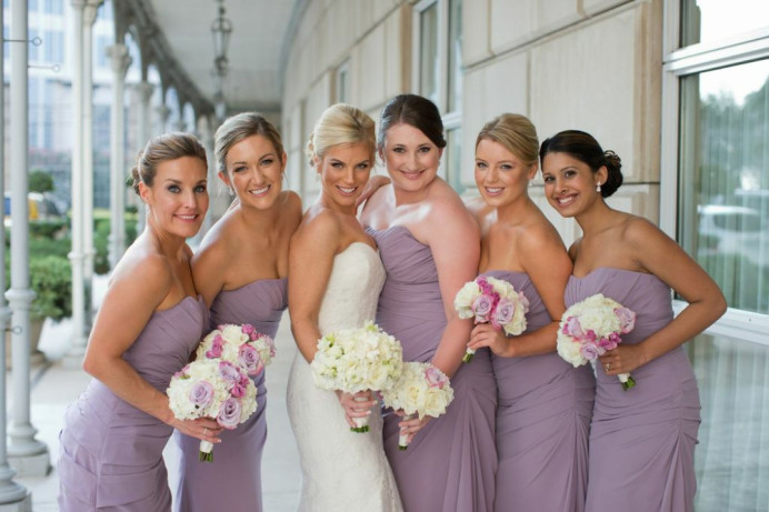 Happy bride with all her bridesmaids by her side. TEXAS, USA - Make Me Bridal Artist: Nipona Khan Professional Hair & Makeup Artist. #dorsetmakeupartist #naturalmakeup #bridesmaidmakeup #bridalmua #bridalparty #hampshiremakeupartist #weddingmakeupartist #bridesmakeup