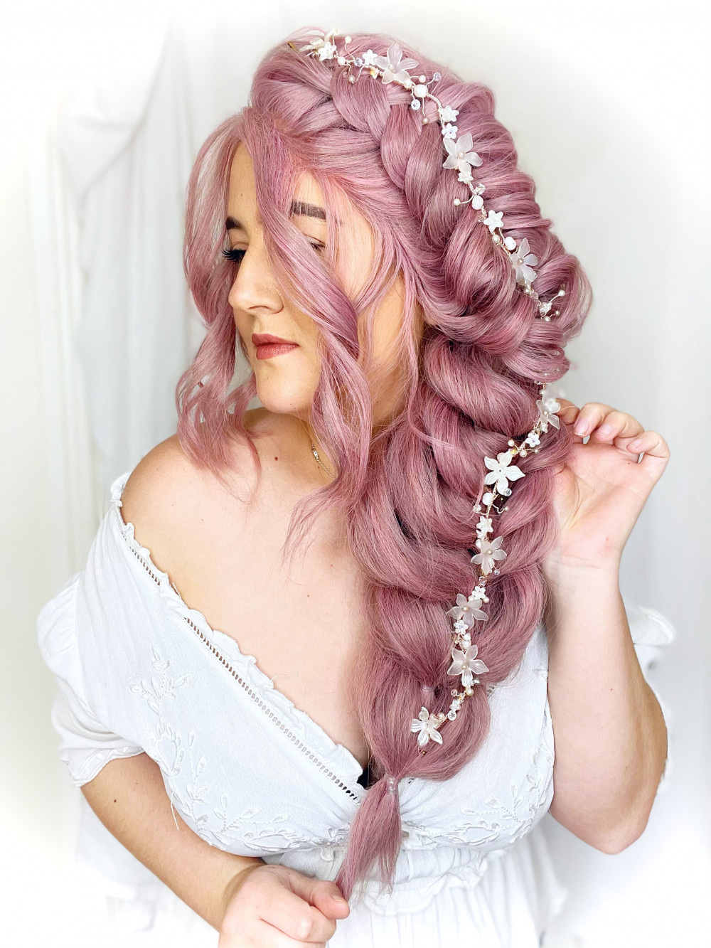 - Make Me Bridal Artist: Parisiumhair. #boho #hairvine #flowersinherhair #bridalhairstylist #hairstyling #photoshoot #styledshoot #pink #braid #plait