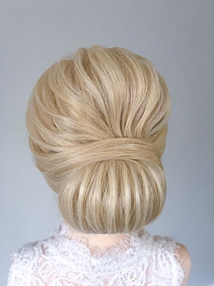 Low classic bridal chignon with ridges - Make Me Bridal Artist: Hairbydanielle. #chignon