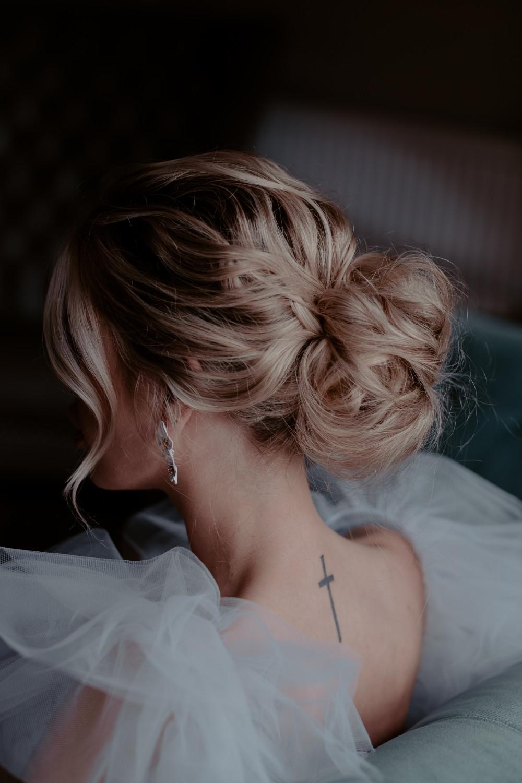 - Make Me Bridal Artist: Hair Creations By Colette. Photography by: Emily Robinson. #bridalhair #messybun #lowbun #texturedupdo