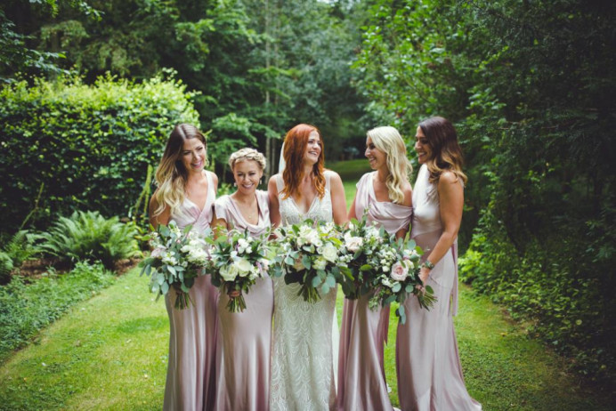 This is a gorgeous photograph of the bride with her bridesmaids, all looking beautiful, I did the makeup for all of these beautiful girls. It was such a beautiful wedding. - Make Me Bridal Artist: I Love It Laura. Photography by: Adam Drake. #naturalmakeup #bridalmakeup #bridesmaidmakeup #bridalparty #naturalweddingmakeup #forthenaturalbride #hertfordshiremakeupartist