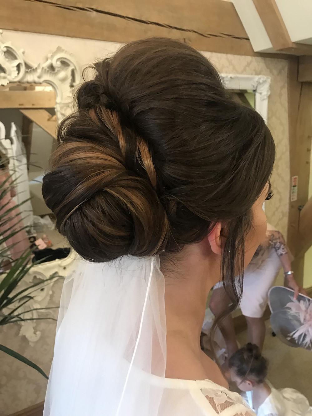 Twisted chignon! - Make Me Bridal Artist: Flame Beauty.