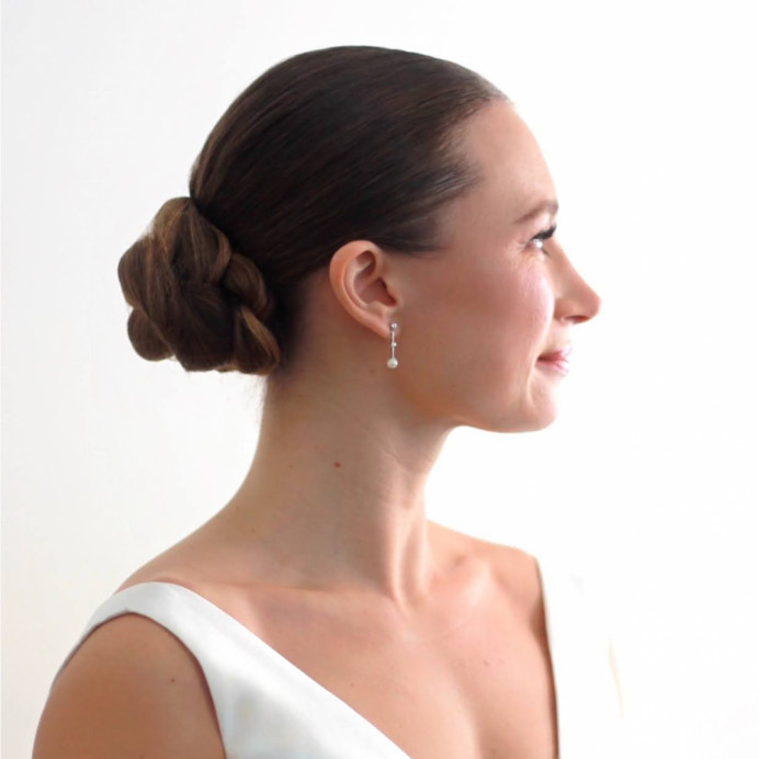 Wedding hair, up do. Sleek plaited chignon - Make Me Bridal Artist: Amanda Roberts Hair & Makeup. Photography by: Amanda Roberts. #classic #updo #chignon #braid #bun #plaitupdo #sleekhair #sophiscated #sleekupdo #lowbun