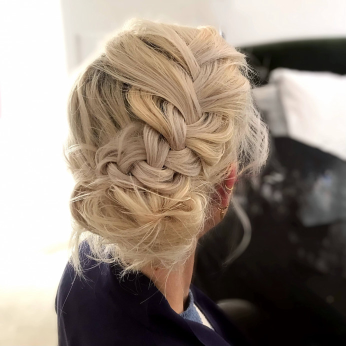 Bridesmaid hair up with soft plait and low bun. - Make Me Bridal Artist: Amanda Roberts Hair & Makeup. Photography by: Amanda Roberts. #bohemian #hairup #bridesmaidhair #braidedupdo #softupdo #plait #plaitupdo #looseplait