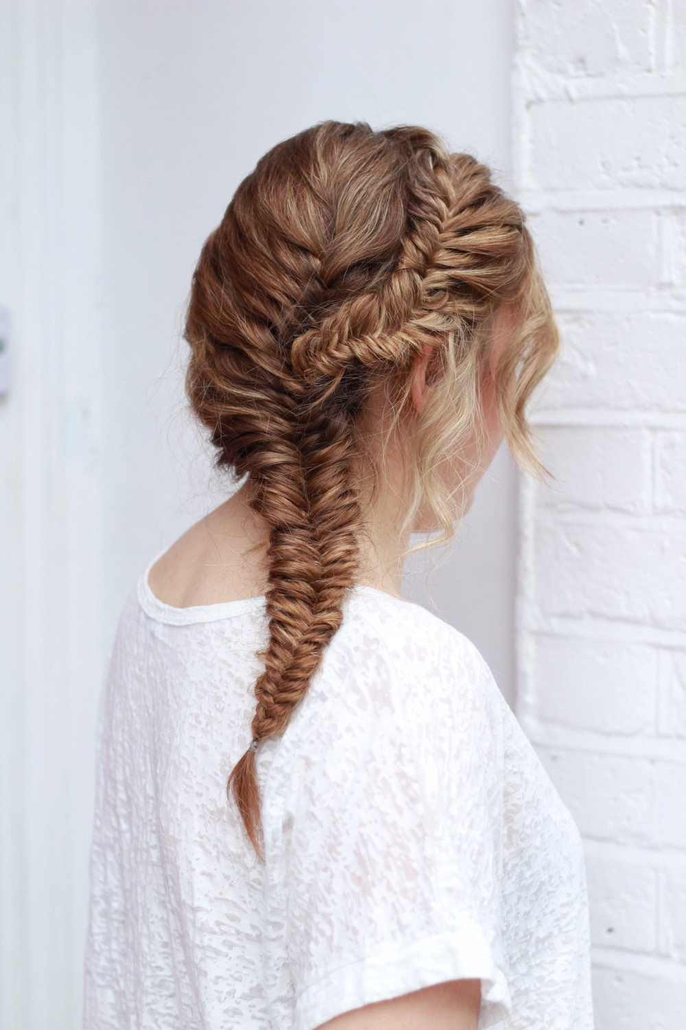 This soft, loose fishtail braid, would look beautiful on either bride or bridesmaid. - Make Me Bridal Artist: Amanda Roberts Hair & Makeup. Photography by: Amanda Roberts. #bohemian #boho #bridalhair #updo #fishtailbraid #fishtail #plait