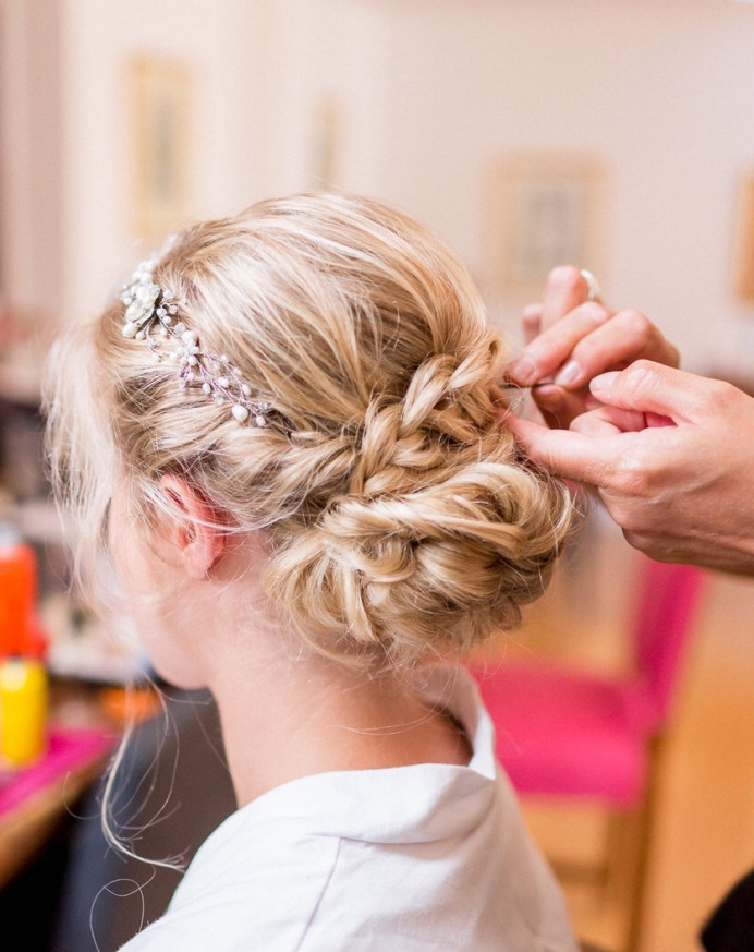 Finishing touches to this bride's plaited up do. - Make Me Bridal Artist: Amanda Roberts Hair & Makeup. Photography by: Philippa Sian . #boho #blonde #hairvine #weddingmorning #bridalhair #braid #braidedupdo #weddinghair #plait #finaltouches