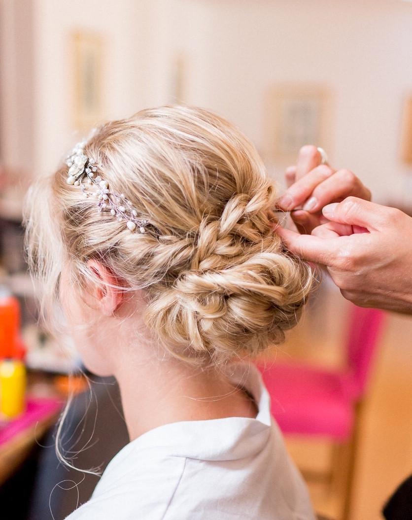 Finishing touches to this bride's plaited up do. - Make Me Bridal Artist: Amanda Roberts Hair & Makeup. Photography by: Philippa Sian . #boho #blonde #hairvine #weddingmorning #bridalhair #braid #braidedupdo #weddinghair #plait #finaltouches