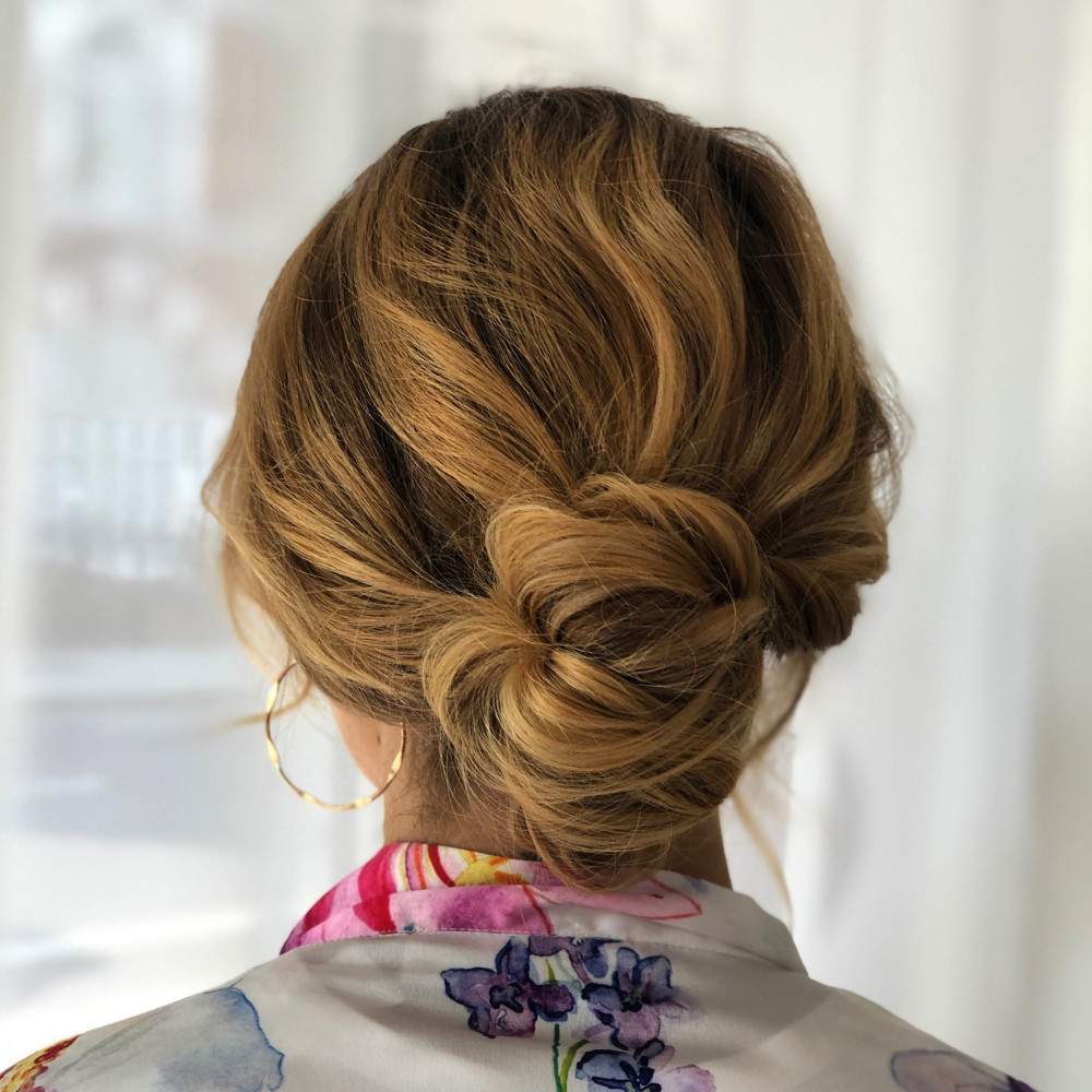 Beautiful undone hair up. This style suits any length of hair and adds a touch of understated elegance.
