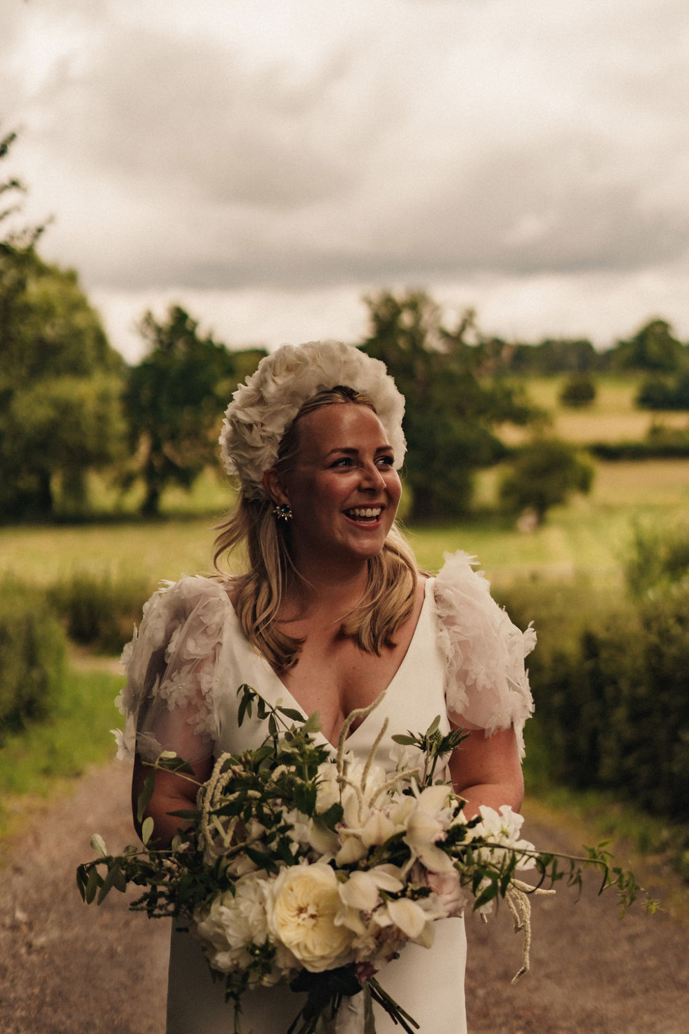 The beautiful Ellen, with that gorgeous dress and statement head piece. - Make Me Bridal Artist: Story Hair and Makeup. Photography by: We are the Chamberlins. #bohemian #naturalmakeup #classic #sleekhair #alternative #polished