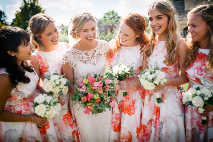 Bride and her bridal party. - Make Me Bridal Artist: Story Hair and Makeup. Photography by: Katie Hamilton. #boho #naturalmakeup #curls #bridalmakeup #bridalhair #flowersinherhair #romantichairup